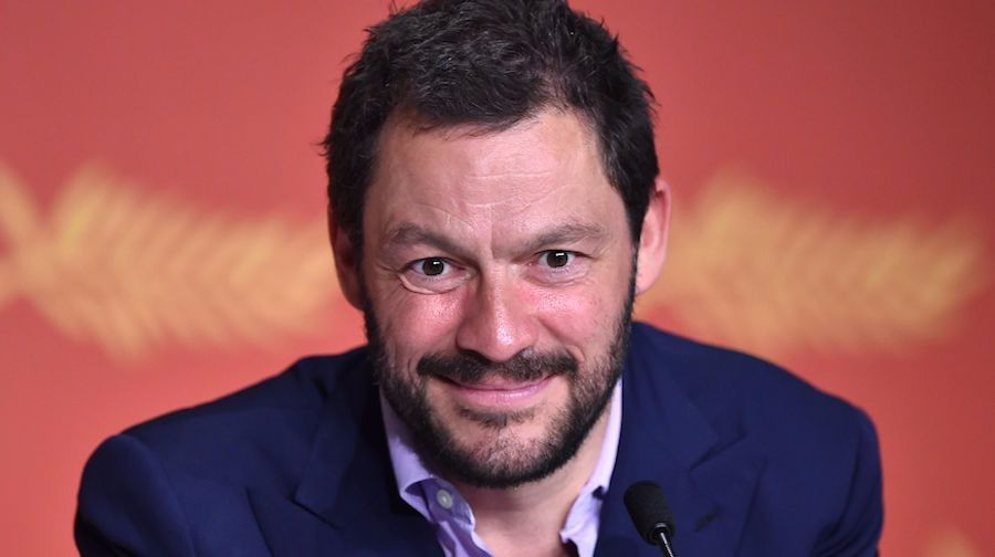 """British actor Dominic West smiles on May 12, 2016 during a press conference for the film """"Money Monster"""" at the 69th Cannes Film Festival in Cannes, southern France.  / AFP / ALBERTO PIZZOLI        (Photo credit should read ALBERTO PIZZOLI/AFP/Getty Images)"""
